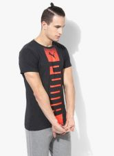 Buy Puma Rebel Dark Grey Round Neck T-Shirt from Jabong