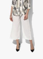 Flat 40% off on W Off White Solid Regular Fit Palazzo