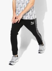 Buy Puma Camo T7 Black Printed Track Pant from Jabong