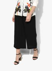W Black Solid Regular Fit Coloured Pants for Rs. 999