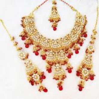 Flat 53% off on Marvelous Zirconic Gold Plated Dark-Red Necklace Set Earrings Tikka Set