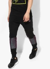 Flat 40% off on Puma Colorblock Black Running Track Pants