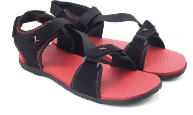 Flat 57% off on Puma Men black-high risk red Sports Sandals