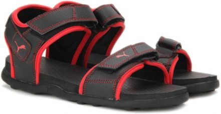 Buy Puma Men Puma Black-High Risk Red Sports Sandals from Flipkart