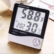 6th Dimensions Digital White Table Clock With Hygrometer, Calender & Thermometer for Rs. 399