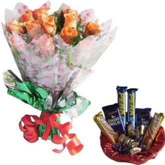 Buy SPECTACULAR COMBO - 12 Peach Roses Hand Bunch with Assorted Chocolate from Amazon