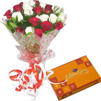 SPLENDID COMBO - 25 Red N White Roses Hand Bunch with Cadbury Celebrations Pack for Rs. 1,400