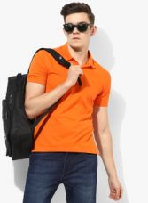 John Players Orange Solid Slim Fit Polo T-Shirt for Rs. 400