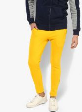 Flat 65% off on United Colors of Benetton Yellow Solid Track Pants
