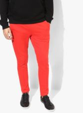 Buy United Colors of Benetton Red Solid Track Pants from Jabong